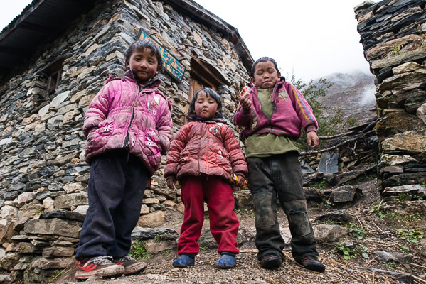 Young boys and girls enjoy the influx of foreigners during two trekking seasons.