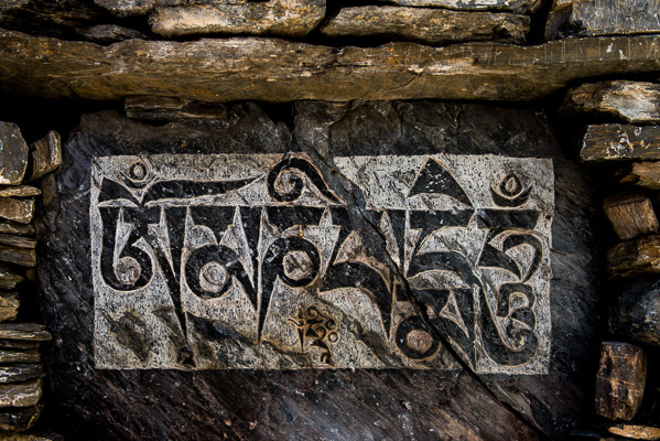 Mani prayer walls are adorned with carved stones throughout Nepal