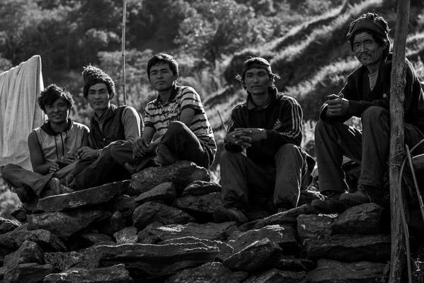 Men taking a break from heir construction work, Tsum Valley
