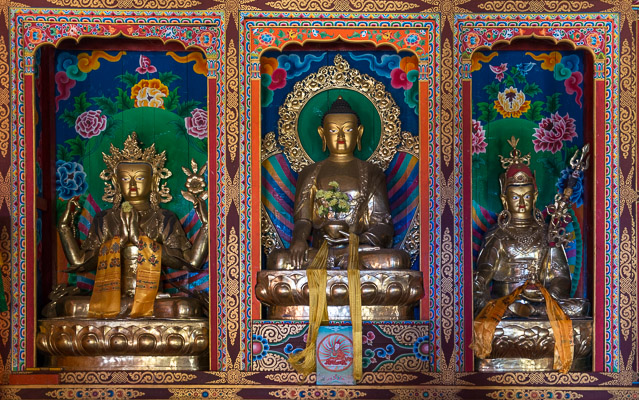 Newly painted Buddhas in Lho