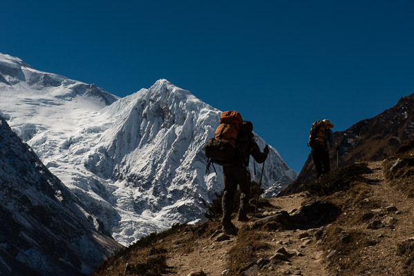 Porters will carry twice the load of visitors, here at 15,000 feet.