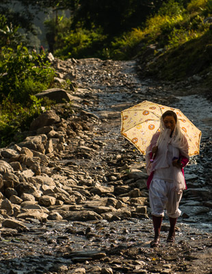 Locals walk home from the cities to celebrate the Dashain Festival.