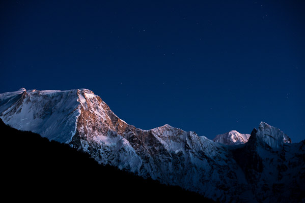 The peaks share the night sky with the stars, Nepal